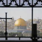 The city of Jerusalem seen through a window, facing Temple Mount on a Holy Land tour