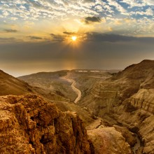 Sunrise over the Dead Sea and the desert wadi of Nahal Dragot